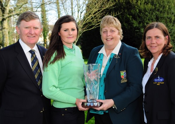 Mary McKenna (President Irish Ladies Golf Union) presenting Olivia Mehaffey (Royal County Down Ladies) with the 2014 Irish Under 18 Girls Open Strokeplay Championship trophy after her victory at Roganstown Golf Club today (Sunday 6th April). Also in the picture are Gerard McNally (Captain, Roganstown GC) and Brenda Craig (Lady Captain, Roganstown GC). Picture by Pat Cashman  www.cashmanphotography.ie