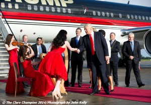 Via the  ClareChampion.ie — Donald Trump is greeted with music as he and his family disembark from his private plane after arriving in Shannon early this morning before heading to view his latest purchase Trump International Golf Links And Hotel Ireland. Picture © John Kelly