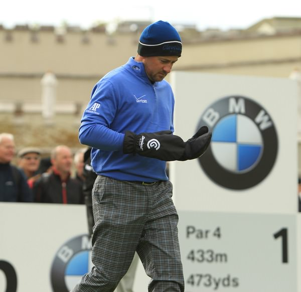 Graeme McDowell braves the elements at Wentworth in 2013.Picture Stuart Adams  www.golffile.ie
