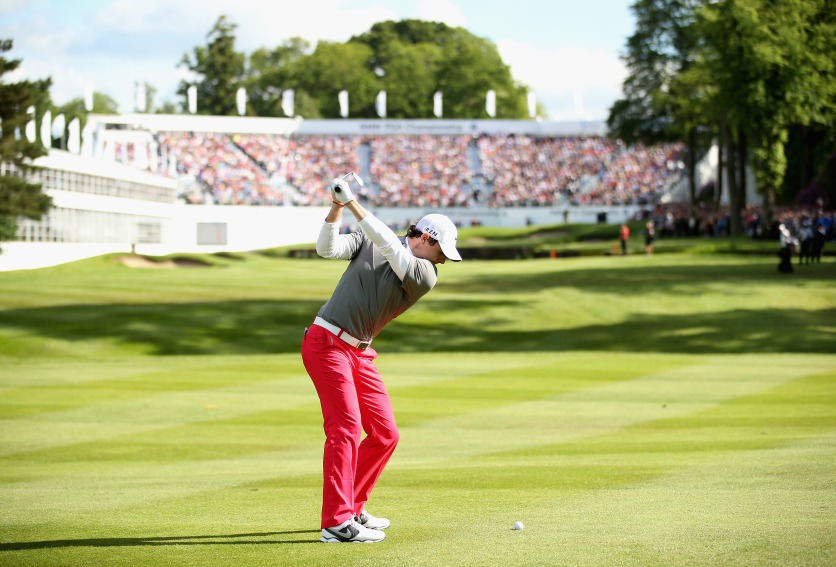 Rory McIlroy hits hit approach to the 18th. Picture, courtesy  www.bmw-golfsport.com  by Richard Heatcote / Getty Images