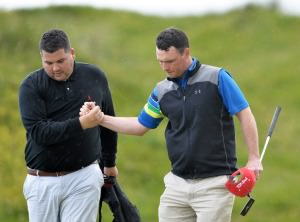 Eoin Arthurs (Forrest Little) with his caddy Dan Whelan celebrate victory on the 18th during the third round of matchplay at the 2014 AIG sponsored Irish Amateur Close Golf Championship at Seapoint Golf Club today (10/06/2014). Picture by Pat Cashman  www.cashmanphotography.ie