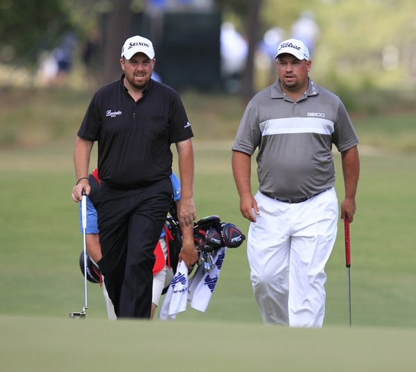 Shane Lowry (IRL) and Brendon De Jonge (ZMB) walk onto the 6th green during Thursday's Round 1 of the 2014 US Open Championship held at Pinehurst No.2 Course, Pinehurst, North Carolina, USA. 12th June 2014. Picture: Eoin Clarke  www.golffile.ie