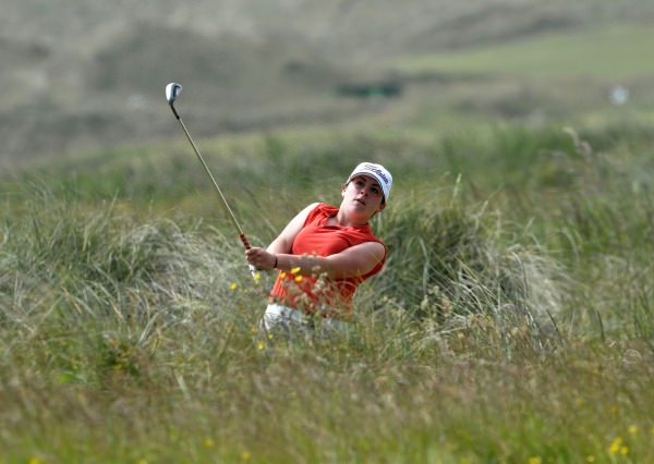 Winner Mary Doyle (The Heath) playing from the rough at the 8th hole in the final of the 2014 Irish Ladies Close Championship at Enniscrone Golf Club. Picture by Pat Cashman  cashmanphotography.ie