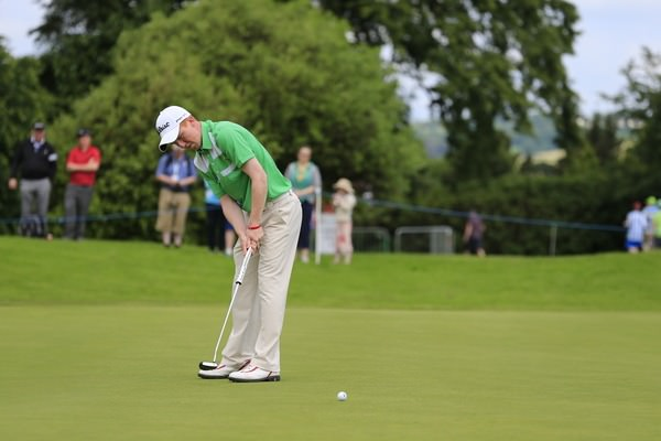 Gavin Moynihan putts on the 16th green during round one of the 2014 Irish Open at Fota Island.Picture: Eoin Clarke  www.golffile.ie