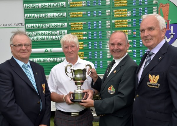 Michael Connaughton (President Elect, Golfing Union of Ireland) presenting Maurice Kelly (Naas) with the 2014 Tourism Malaysia sponsored Irish Seniors Amateur Close Championship trophy after his victory at Tullamore. Also pictured are Joe Feely (Captain, Tullamore Golf Club) and Willie O'Grady (President, Tullamore Golf Club).Picture by Pat Cashman  www.cashmanphotography.ie