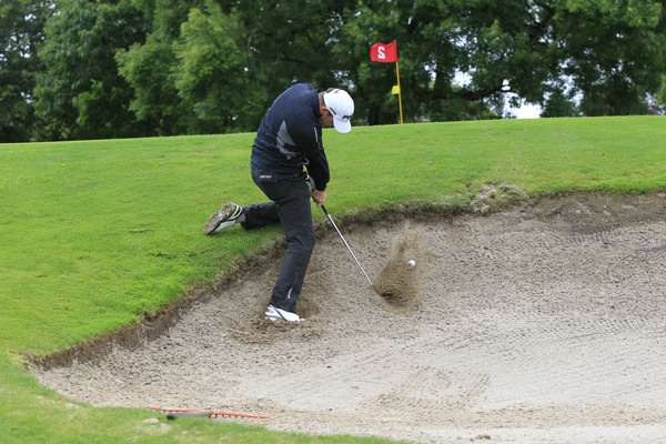 Richard Knightly (Royal Dublin) plugged in a bunker on the par-three second during round 1 of the Mullingar Electrical Scratch Trophy at Mullingar Golf Club on Sunday 3rd August 2014.Picture: Thos Caffrey /  www.golffile.ie