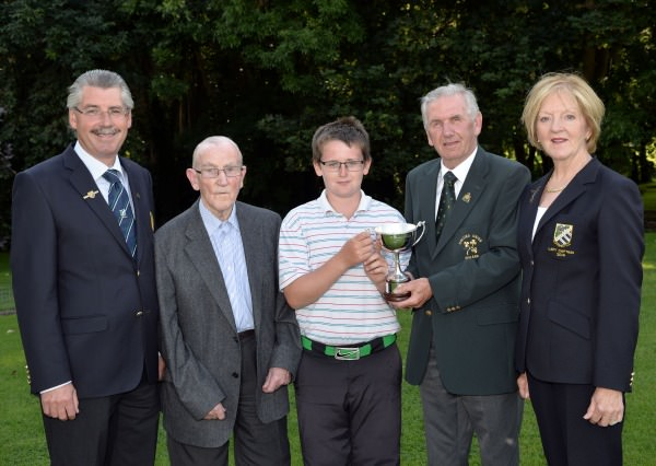 Albert Lee (Hon Secretary, GUI) presenting Patrick Callaghan (Castle Dargan) with the 2014 Irish Boys Under 13 Amateur Open Championship trophy (Craddock Cup) after his victory at Malahide Golf Club (11/08/2014). Also in the picture are (from left) Tommy Rusk (Captain, Malahide Golf Club), Paddy Craddock and Pauline Chawke- Clancy (Lady Captain, Malahide Golf Club), Picture by  Pat Cashman