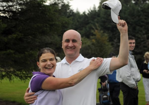 Denny Sinnott (Waterford Castle) hugs his partner Fiona Fitzgerald after she holed the winning putt on the 16th green in the final of the I Need Spain Irish Mixed Foursomes at Warrenpoint Golf Club (05/09/2014). Picture by  Pat Cashman