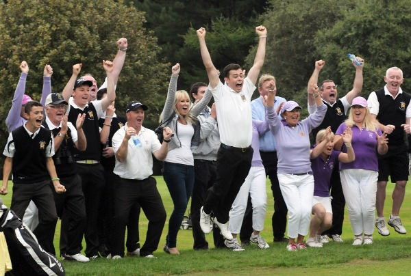 Waterford Castle player Sam Power leads the victory dance at the 16th green in the final of the I Need Spain Irish Mixed Foursomes at Warrenpoint Golf Club(05/09/2014). Picture by Pat Cashman
