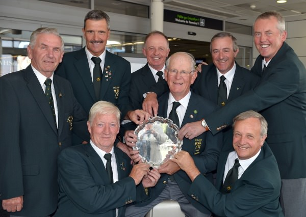 European Seniors Champions. Irish Seniors Team Captain Tony Goode (Lucan) with the 2014 European Senior trophy and team members (clockwise) Team Manager Albert Lee (Mullingar), Adrian Morrow Portmarnock), Tom Cleary Cork), Michael Quirke (Doneraile), John Mitchell (Tramore), Arthur Pierse (Tipperary) and Maurice Kelly (Naas) on their return to Dublin Aiport (07/09/2014) after their victory in Poland. Picture by  Pat Cashman
