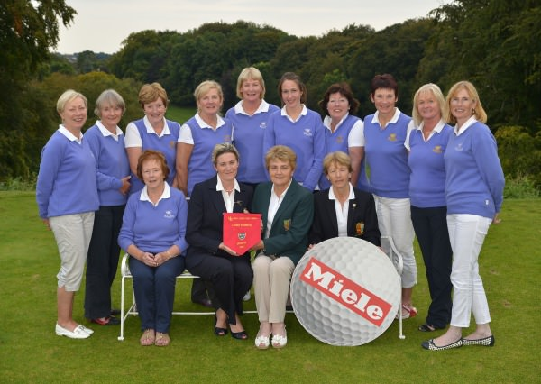 Vonnie Noonan (ILGU Board Member) presenting Julie Connolly (Lady Captain, Cahir Park Golf Club) with the 2014 Miele All Ireland Ladies Interclub Fourball Regional Final pennant after their victory at Athlone Golf Club. Also in the picture in front are Imelda Dilleen (Team Manager) and Lily O'Sullivan (Lady Captain, Athlone Golf Club). At back (from left) Caitlin Fitzgerald, Yvonne Morrison, Chris Noonan, Patricia Brown, Bridget Walsh, Michelle Keating, Phil Barry, Susan Carey ( Joint Team Manager), Breda Keating and Imelda Fitzpatrick. Picture by  Pat Cashman