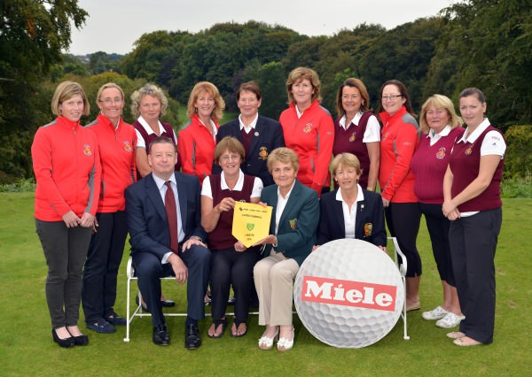 Vonnie Noonan (ILGU Board Member) presenting Sylvia Alcock (Lady Captain, Skerries Golf Club) with the 2014 Miele All Ireland Ladies Interclub Fourball Regional Final pennant after their victory at Athlone Golf Club. Also in the picture in front are Pat McGrath (Miele Ireland) and Lily O'Sullivan (Lady Captain, Athlone Golf Club). At back (from left) Tara Duggan, Barbara Ryan, Mary Kenny, Joyce Gillespie, Christine O'Brien (Lady President, Skerries Golf Club), Bridgeen Kiernay, Grainne O'Connor, Joanne Kinsella, Nuala MacMahon (Team Manager) and Fiona Farrell.Picture by Pat Cashman