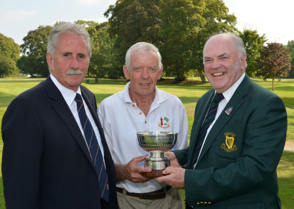 Joe McNamara (Hon Treasurer, Leinster Golf, GUI) presenting Bert Burke (Moate) with the 2014 Leinster Veterans Amateur Open Championship trophy after his victory at Athy Golf Club (10/09/2014). Also in the picture is Tom Myers (Captain, Athy Golf Club). Picture by  Pat Cashman