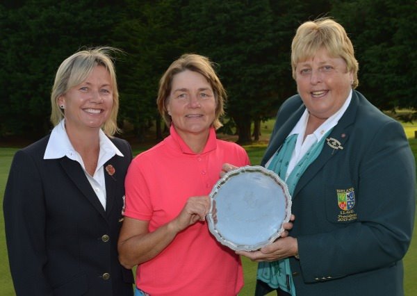 Mary McKenna (President, Irish Ladies Golf Union) presenting Minna Kaarnalahti (Finland) with the 2014 Irish Senior Women's Open Strokeplay trophy after her victory at Dundalk Golf Club (12/09/2014). Also in the picture is Anne Doohan (Lady Captain, Dundalk Golf Club).  Picture by  Pat Cashman