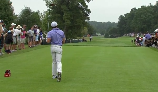 Rory McIlroy watches his drive sail right on the ninth.