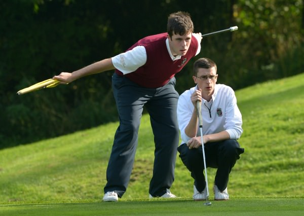 Castletroy's Keith Bermingham with his caddy Ian Irwin lining up his putt in the semi final of the AIG Junior Cup at Carton House today (17/09/2014). Picture by Pat Cashman