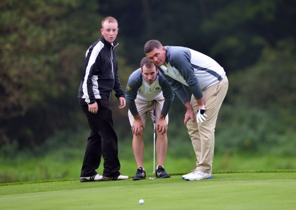 Evan Talty and Mervin Hehir (Spanish Point) with caddy Declan Talty lining up their putt at the 14th iin the final of the AIG Pierce Purcell Shield at Carton House (19/09/2014).  Pat Cashman