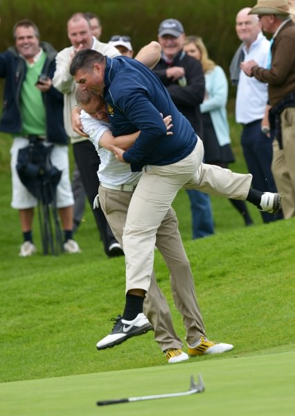 Tramore's Alan Thomas (left) celebrates with Chris Butler after he holes his birdie putt on the 19th to clinch the AIG Senior Cup at Carton House today (20/09/2014).  Pictures by  Pat Cashman