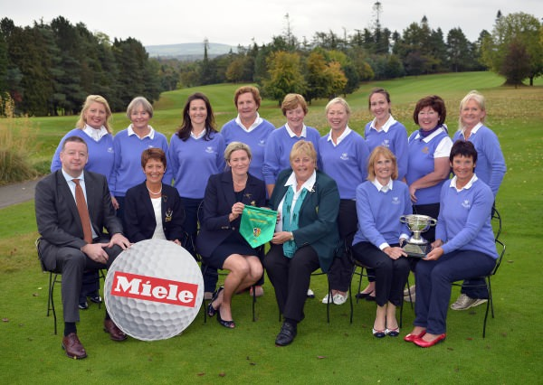 Mary McKenna (President, Irish Ladies Golf Union) presenting Julie Connolly (Lady Captain, Cahir Park Golf Club) with the 2014 Miele All Ireland Ladies Interclub Fourball pennant after their victory at Naas Golf Club today (05/10/2014). Also in the picture are in front (from left) Pat McGrath (MD Miele Ireland), Maura Murphy (Lady Captain, Naas Golf Club), Imelda Fitzpatrick (Team Manager) and Susan Carey.At back (from left) Bernie Carroll, Yvonne Carroll, Emma Keating, Marie Keating, Chris Noonan, Caithlin Fitzgerald, Michelle Keating, Phil Barry and Breda Keating.  Picture by   Pat Cashman