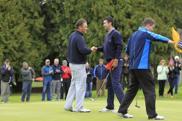 Michael McGeady congratulates Niall Kearney on his win in the Irish Professional Championship at Adare Manor. Sunday 5th October 2014. Picture: Thos Caffrey /  www.golffile.ie