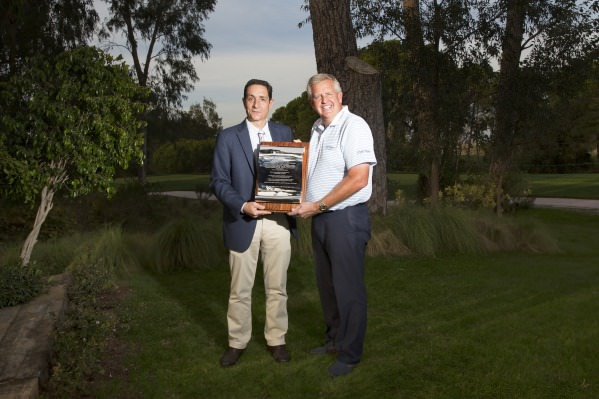 Miguel Vidaor of the European Tour presents Colin MOntgomerie with a silver scroll listing his achievements ahead of his 600th European Tour appearance this week. Credit: Kevin Murray /  kevinmurraygolfphotography.com