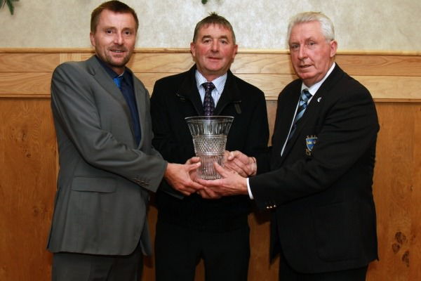 Ger Keane of Keanes Jewellers Cork (sponsor) presents Richie Hurley (Gary Hurley's father) with the 2014 Munster Senior Golfer of the Year Award. Also pictured, John Moloughney, Chairman GUI Munster Branch