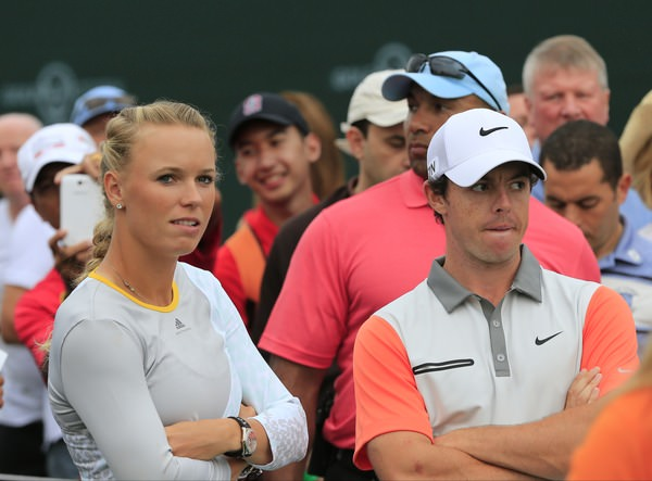 Caroline Wozniacki and Rory McIlroy wait onthe 17th tee during thefinal round of the 2014Omega Dubai Desert Classic.2nd February 2014.Picture: Eoin Clarke  www.golffile.ie