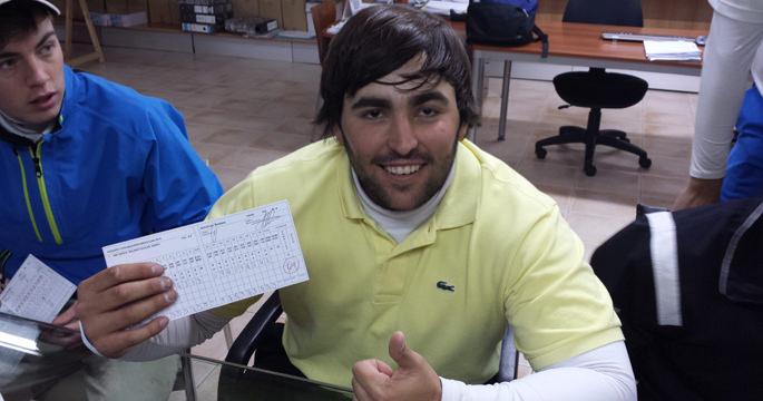 Mario  Galiano shows off his card