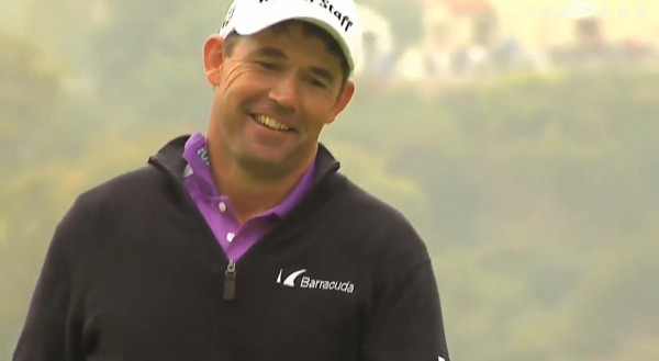 Pádraig Harrington smiles wryly after his eagle putt lips out at the first.