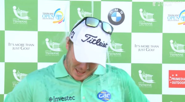 George Coetzee couldn't avoid a soaking from well wishers during his TV interview