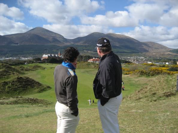 Rory McIlroy gets some advice from fellow Co Down man Ronan Rafferty at Royal County Down in 2007