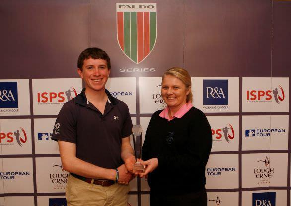 Ted Higgins Jnr receives the Faldo Series Ireland Championshiptrophy from Lough Erne's PGA professionalLynn McCool in 2014