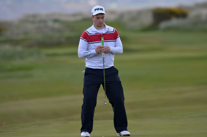 Jack Hume (Naas) gets a feel for the line of his putt atThe Royal Dublin Golf Club. Picture by  Pat Cashman