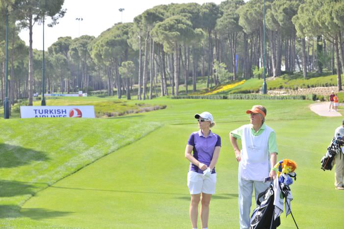 Rebecca Codd and her caddie Fred during round one of the Turkish Airlines Ladies Open at The Carya in Antalya