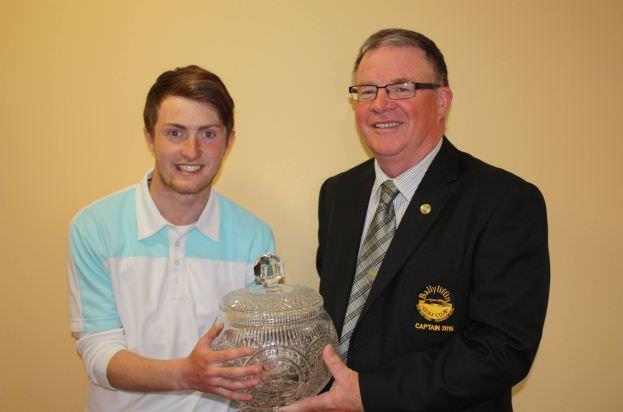 Winner Jamie Foley (Letterkenny GC) receives the Ballyliffin Senior Scratch Cup fromBallyliffin GC Captain Phelim Davenport.