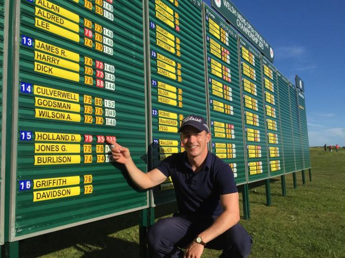 Daniel Holland points to his course record in Wales