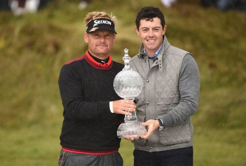 DUBAI DUTY FREE IRISH OPEN WINNER SOREN KJELDSEN WITH RORY MCILROY AND THE HOUSE OF WATERFORD CRYSTAL TROPHY. PICTURE Getty Images