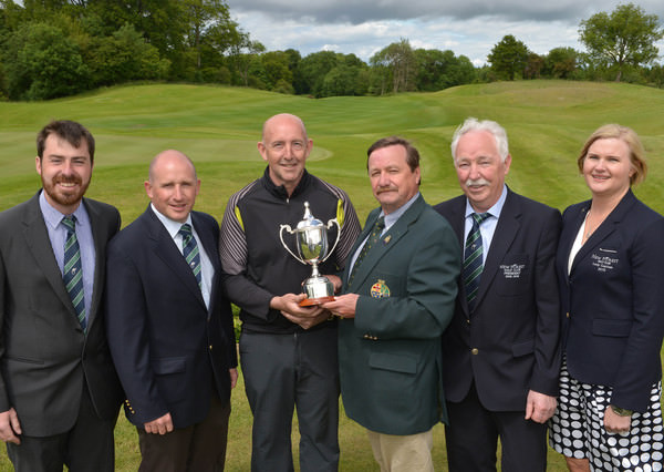 Kevin McIntyre (President Elect, GUI) presenting Tony McClements (Hollywood) with the 2015 Irish Mid Amateur Open Championship trophy after his victory at New Forest Golf Club. Also in the picture are (from left) Des Morgan (Golf Director, New Forest Golf Club), Conor McGuinness (Vice Captain, New Forest Golf Club), John Cunningham (President, New Forest Golf Club) and Sherrie E Buckley (Lady Captain, New Forest Golf Club). Picture by  Pat Cashman