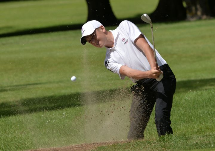 Winner of the Under 17 trophy Oliver Clarke (England) coming from the bunker at the 11th green in the final round of the Irish Boys Amateur Open Championship. Picture by Pat Cashman