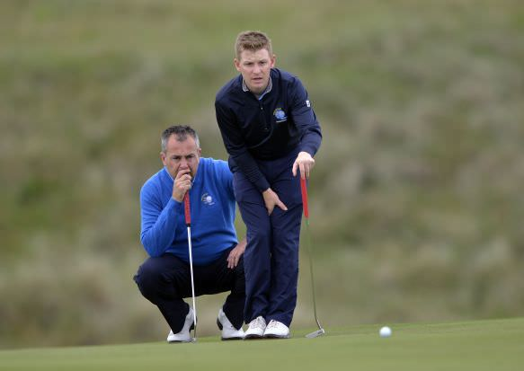 Munster's Pat Murray and Geoff Lenehan lining up a putt on the first day of the 2015 Interprovincial Championship at Rosapenna Golf Club today. Picture by Pat Cashman