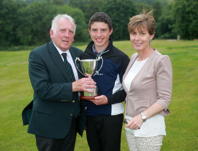 John Ferriter (Leinster Golf) presentsOdhrán Maguire and his mother Breda with the Leinster Boys Under 14 Open Championshipat Delgany.Picture: Ronan Temple Lang