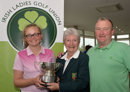 Irene Poynton (Director of Junior Golf, ILGU) presenting Annabel Wilson (Lurgan) with the 2015 Irish Girl's Close Amateur Championship trophy (Blake Cup) after her victory at Galway Bay Golf Club(18/07/2015).Also in the picture is Andy Wilson (Father). Picture by  Pat Cashman