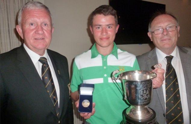 Paul Muldowney, Captain Grange GC (left) presentsCharlie Denvir (Powerscourt GC) with the Allianz Grange Dublin BoysChampionship trophy. Also pictured, Donal Bollard,Allianz.