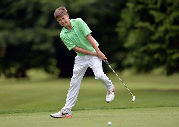 Winner Alex Maguire (Laytown & Bettystown) reacts to his missed birdie putt on the 12th green in the 2015 Irish Boys Under 14 Amateur Open Championship at Roscrea. (30/07/2015). Picture by  Pat Cashman
