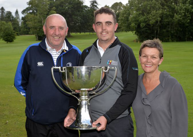 Alan Lowry, flanked by his parents Brendan and Brigid, with the 2015 Mullingar Electrical Scratch Trophy.