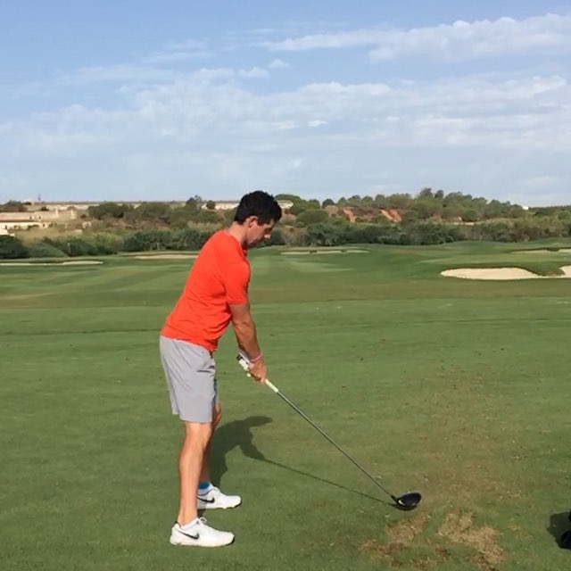 McIlroy hits a driver. Is that strapping on his left ankle?