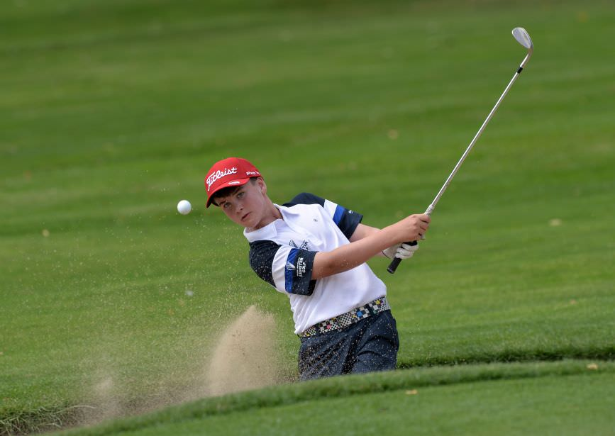 Joshua McCabe (Roganstown) bunkered at the 15th hole during the 2015 Leinster Boys' Under 13 series Final (sponsored by Titleist) at the Castle Golf Club (06/08/2015). Picture by  Pat Cashman
