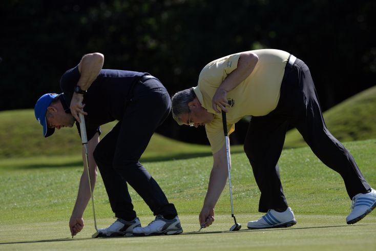 Alan Dowling (Hermitage)and Barry Forsyth (Corballis Links) repairing pitch marks on the 5th green in the final round of the 2015 Leinster Mid Amateur Open Championship atGrange (08/08/2015). Picture by  Pat Cashman