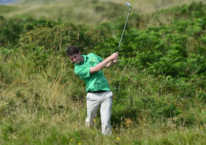 Dermot McElroy (Ireland) playing from the rough at the 9th hole during the second day of the 2015 Home International Matches.Picture by  Pat Cashman