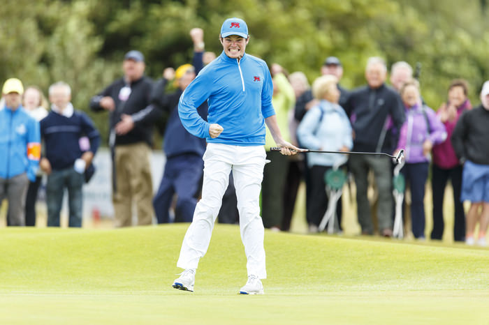 Ardglass' Cormac Sharvin reacts after making his putt on the 14th hole to win the match during the morning foursomes matches of the 2015 Walker Cup at Royal Lytham & St. Annes G.C. in Lytham St Annes, Lancashire on Saturday, Sept. 12, 2015. (Copyright USGA/Chris Keane)